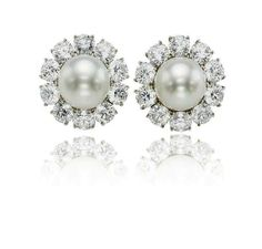 A pair of fine natural pearl and diamond earrings