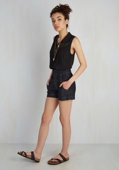 You're week-long staycation began the moment you clocked out, and the at-home fun and relaxation commenced as soon as you traded work slacks for denim shorts. These pocketed bottoms in dark wash feature a high-waisted silhouette complete with glossy black buttons and a retro flair you'll love to flaunt at home, or out on the town!