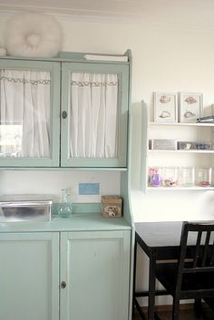 Ikea hutch- painted green with fabric inside glass doors