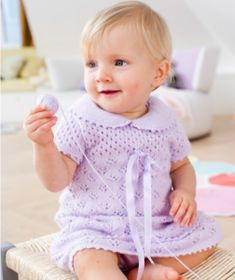 Very sweet lace baby dress to knit up with short sleeves and collar. Free knitting pattern for a baby dress. Knitting pattern for a baby dress.