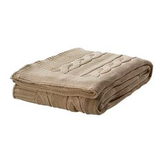I would be happy to cuddle up with this beige throw in front of a fireplace.  -  URSULA Throw IKEA