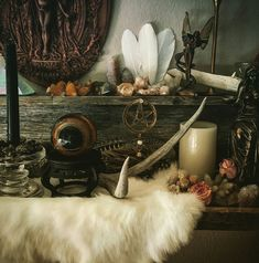 Beautiful rustic pagan altar with a white fur and antlers