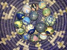 Larry Castle High-fired, unglazed porcelain MARBLES ranging over a 10 year period.  Larry with Marlow Peterson co-authored 4 marble books.