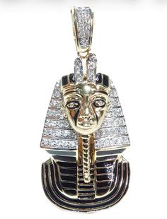 22.30 Grams of 10k Yellow Gold with gorgeous SI1 quality Round cut diamonds this Pharaoh Pendant is hard to pass up.