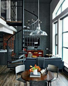 black, double height space, spiral staircase
