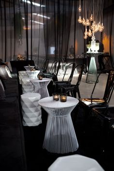 Interesting tables for round bar area/soft seating. Not in white though? Also love the hanging light bulbs. #eventdecor Black Lounge, Corporate Event Design, Lounge Decor, Lounge Furniture, Furniture Ideas, Round Bar, Wedding Lounge, Lounge Areas, Event Management