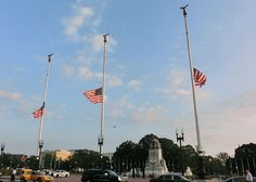 "Photo of American flags flying at half staff on Columbus Circle, Washington, D.C., on Patriot Day 11 September 2013. Source: T. H. Kelly; Wikimedia Commons. Read more on the GenealogyBank blog: ""Patriot Day: Remembering 9/11."" http://blog.genealogybank.com/patriot-day-remembering-911.html"