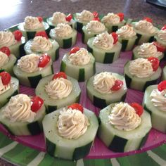 Stuffed cucumbers vegetable cream cheese topped with cherry tomato and sprinkled with lemon pepper