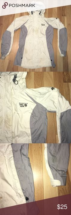 Mountain hardware rain jacket In used condition. Has stains and discoloration. The jacket has two armpit zips for ventilation. Has two side pocket and one internal mesh pokey. The hood has a beak and a back adjusting hardware. Was used heavily for backpacking and has performed super great. Sad to let it go but I replace it with a different jacket. Please bundle and get a free item of your choice - lowest value. Mountain Hard Wear Jackets & Coats