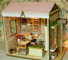 Fate's smile miniature dollhouse craft room-so cute! This link goes to the page, but not to this particular project. I will have to go back and search for more photos when I have time. So, I couldn't wait and went back to the blog. It's taking forever to find all of the photos of what is actually a dollhouse shop. In between are a lot of food posts. Still, I'm determined, because I love miniatures of miniatures, and there aren't many dollhouse shops in miniature.