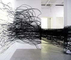 Polish artist Monika Grzymala filled a London gallery with lengths of black and white sticky tape at an exhibition that opens in October 2011....