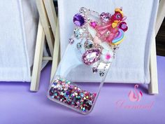 Take any simple white back cover and decorate it using shiny and glittery decorative items. You back cover turns wonderful.