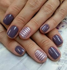 Gray and purple striped nail art design. A cool play on metallic and gray nail polish painted in stripes design with matte purple polish nails.