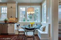 Built in breakfast nook surrounded by windows