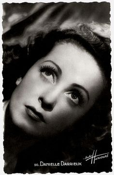 Happy birthday, Danielle Darrieux! French postcard by SERP, Paris, no. 90. Photo: Studio Harcourt.    Today is the birthday of French actress and singer Danielle Darrieux (1917), an enduringly beautiful, international leading lady. From her film debut in 1931 on she progressed from playing pouty teens to worldy sophisticates. In the early 1950's she starred in three classic films by Max Ophüls, and she played the mother of Catherine Deneuve in five films! Happy 96, mme. Darrieux.