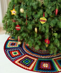 Granny Tree Skirt - free pattern from Red Heart.  Interesting technique for making these trapezoids rather than squares to achieve a circle.   . . . .   ღTrish W ~ http://www.pinterest.com/trishw/  . . . .   #crochet #granny_square