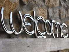 Horseshoe welcome sign... kinda want to get my dad or one of my brothers to make this!
