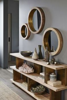 Round mirrors are held by thick wooden frames that evoke the glamour of a luxury liner. Shiny brass trim on the inner rim accentuates the clean and simple desig #luxuryfurnituredesign