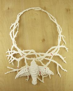 Like I just died and went to heaven. Papercut! Kahlo inspired necklace. By Elsa Mora who is obviously a genius.