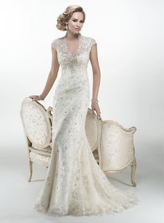 Odette - by Maggie Sottero Stunning beaded embroidered lace with metallic accents and Swarovski crystals on Glitter tulle sheath overlays a separate Orlando satin slip dress, accented with keyhole back.