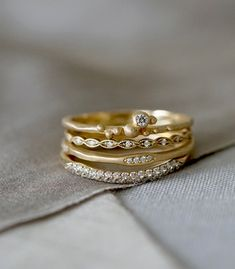 Rustic and refined, the Sienna stack is composed of four 14K gold and diamond rings, and delights us with an unexpected mix of textured and smooth surfaces, refined and organic settings, shiny and matte finishes. She's complex... just like you.