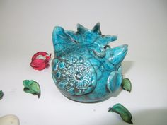 chicken,turquoise colored glaze raku fired,with black crackle effects,may have some copper coloring on glaze