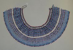 The Xhosa (and related people) of the Eastern Cape wore large beaded collars. The fashion was popular with both genders of all age groups. African Dress, African Art, African Style, African Jewelry, Tribal Jewelry, Nifty Crafts, Xhosa, Beaded Collar, African Culture