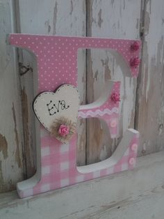 These letters look fabulous in any girls bedroom Painted in off white and shabbed up Decoupaged in pink papers Ric Rac Small wooden heart can be Decoupage Letters, Paper Mache Letters, Diy Letters, Decoupage Ideas, Nursery Letters, Wood Letters Decorated, Painting Wooden Letters, Painted Letters, Wooden Letter Crafts