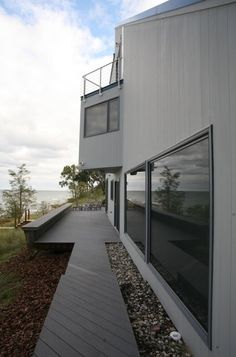Wonderful Geometric House Architecture Symbolizes Tough Image: Striking Contemporary Deck With Wooden Pathway Modern Lakefront Exterior Wooden Pathway, House Architecture, Pathways, Contemporary, Modern, Deck, Stairs, Exterior, Outdoor