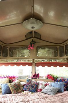 Niki Robinson uses an old Vickers 'Lunedale' gypsy caravan | sofa and bed with fabrics by Kaffe Fassett