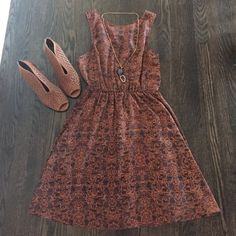 Brown and purple patterned dress Light and airy summer dress with brown purple and red paisley pattern. Has a slight waist seen in and back has a 4 strap neckline into a v. One of my faves!! Everly Dresses