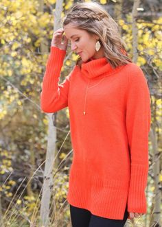 Every Once in a Style sports this bright orange side-zip turtleneck sweater with delicate gold accessories | Banana Republic