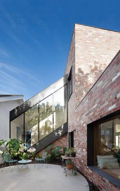 An internal courtyard Hertford Street House featuring reclaimed brick and a steel and glass staircase structure Brick Facade, Facade House, Brick Cladding, Brick Architecture, Residential Architecture, Amazing Architecture, Clare Cousins, Recycled Brick, Internal Courtyard