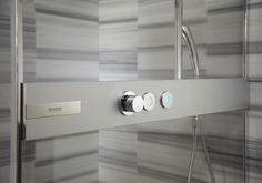Toto's Neorest Shower Booth lets you control the water's temperature and volume from outside the shower, and a LED light turns on when the water reaches its desired temperature. The touch button control panel is also accessible inside the shower.