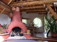 fireplace in a cute cob house