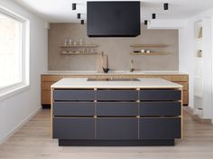 Hamran + Tingbø. Hamran Kitchen. Extraordinary kitchens from Norway. Kitchen inspiration. Scandinavian design. Silestone worktop. Elm cabinets. Integrated pulls/cut outs for handles in elm. Lacquered grey cabinets. Elm shelves.