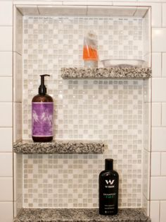 """Snow & Ice #Bathroom, recessed soap & shampoo niche. American Olean white 3"""" x 6"""" subway tile with Pepper Granite shelves.  Crossville Ebb & Flow glass mosaic tile in SNow & Ice. By J.T. McDermott Remodeling."""