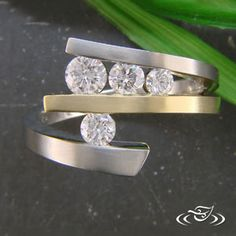 Really amazing settigng.  Work with an artist at Green Lake to design your own custom, hand made ring! http://www.greenlakejewelry.com/gallery/gallery.aspx?p=1