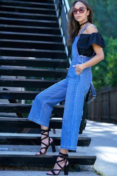 Ashley Madekwe layers an off-the-shoulder top under denim dungarees.