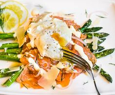 Roasted Asparagus, Home Cured Gravlax and Poached Egg Breakfast Stack. Finished with a dijon-creme fraiche sauce and sprinkled with dill & parmigiano.
