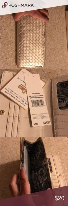 Adrienne Vittadini Studio Cell Phone Wallet NWT, room for cellphone 📱, currency I.d. and credit cards!  Complete with RFID, designed to keep cc's safe from scammers!  This is brand new and never used!  Great for the gal whom loves all things GOLD! Adrienne Vittadini Bags Wallets