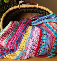 This is a multi-stitch striped pattern blanket using easy stitches that are great for the beginner. The size and gauge of the pattern depends on the size of stitches used and the size of the blankets. 17 skins of Stylecraft Special dk yarn was used for this blanket.