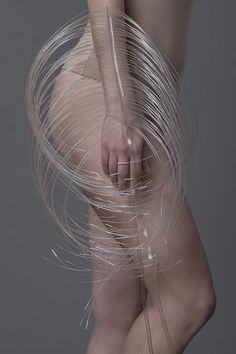 Jewellery designed to cover limbs in porcupine-like spines.