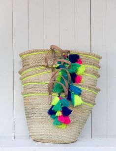 Our market baskets, hand made in Morocco, make fabulous eco-friendly shopping or useful storage baskets. The straps are made from genuine leather and the pom-poms and tassels are each made by hand. Pom Pom Crafts, Ibiza, Market Baskets, Basket Bag, Summer Bags, Storage Baskets, Diy And Crafts, Tassels, Creations