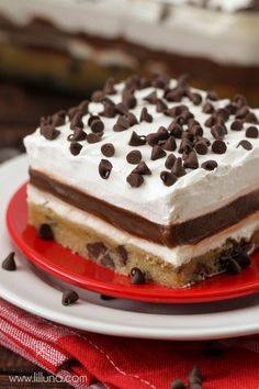 Cookie Delight - A delicious and cool layered dessert with a cookie base, cream cheese and pudding layer all topped off with Cool Whip and mini Chocolate Chips. AMAZING! { lilluna.com }