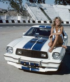 Farrah with her Cobra II on the set of Hellride (Charlie's Angels) (S1.E1). 1976