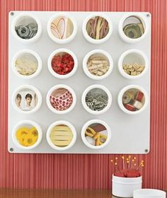 Use Spice Containers: These squat, clear-topped jars (sold at kitchen supply stores) can keep the loose bits that accumulate on your desktop and in your drawers—stamps, Post-it notes, paper clips, rubber bands, etc., etc., etc.—under control.