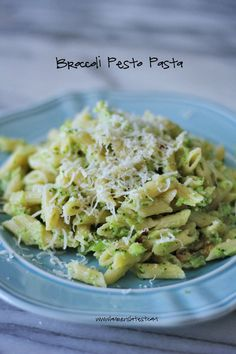 Broccoli Pesto Pasta |  4 cups broccoli florets  1/2 lb. short cut pasta, such as mini penne  2 tablespoons olive oil  1/2 cup diced yellow onion  2 cloves minced garlic  2/3 cup grated parmesan cheese {use the real stuff please!}  reserved pasta water or heavy cream  salt and pepper, to taste