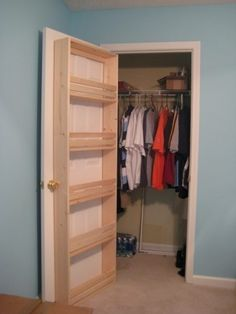 such a good idea, put shelves on the inside of door so you can make use of bottom part of closet for more shelves or another bar