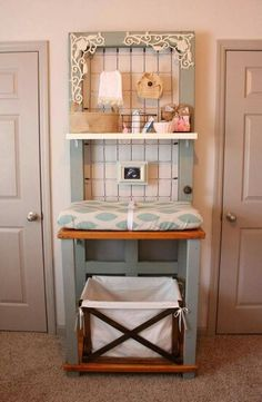 Door changing table. This site has quite a few DIY ideas that I like, including the alphabet walls, garlands and  giraffes. Many would be easy to do on even on  a tight budget.